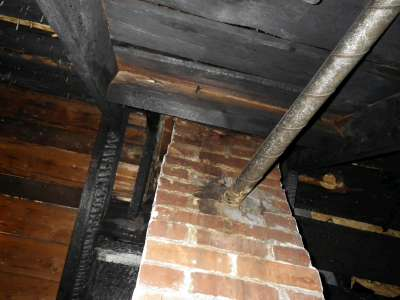 Prior fire, unlined chimney with plumbing vent connected.