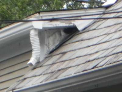 Poor flashing, downspout on roof.