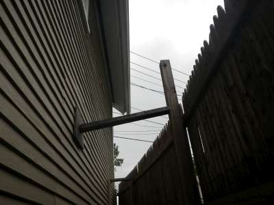 Neighbors fence braced on subject home.