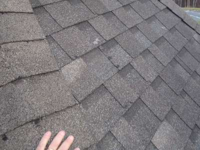 Damaged shingle from shoveling.