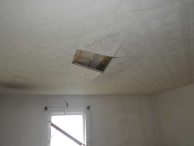 Loose ceiling material from moisture.