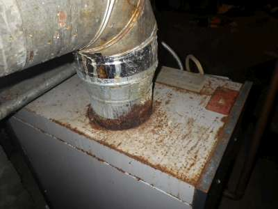 Rusted through exhaust pipe on a recently serviced heating system.