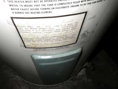 1984 hot water tank, stains below.