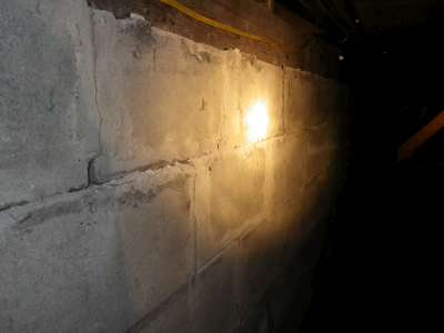 Bowed block foundation in a crawlspace.