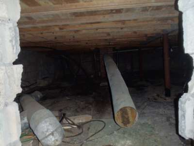 Exhaust pipe disconnected in a crawlspace.