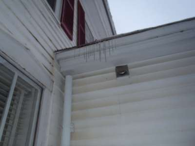 Plumbing vent stack is external, below roof line.