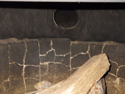 Worn firebrick in the wood stove